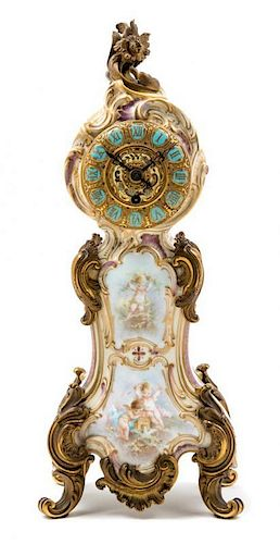 * A French Gilt Bronze Mounted Porcelain Clock Height 13 3/4 inches.
