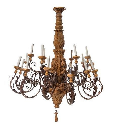 A Carved Wood Twenty-Seven Light Chandelier Height 47 5/8 x diameter 39 inches.