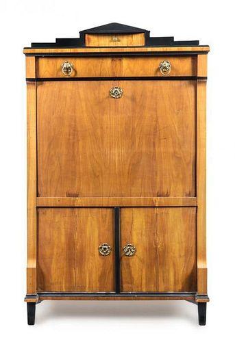 A Biedermeier Parcel Ebonized Cherry Secretary Height 63 1/4 x width 38 x depth 19 inches.