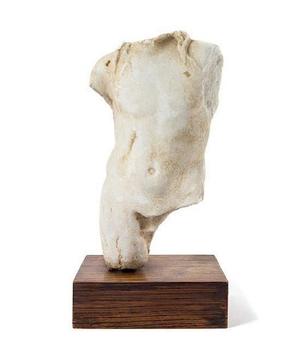 * A Roman Marble Torso of a Deity Height of torso 15 3/8 inches.