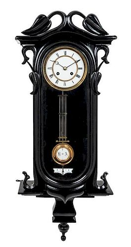 An Austrian Black Lacquered Wall Clock Height 33 inches.