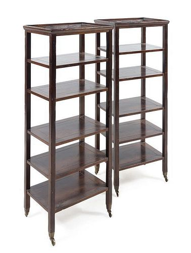 * A Pair of Hardwood Six-Tier Etageres Height 50 1/2 x width 19 1/2 x depth 14 1/2 inches.