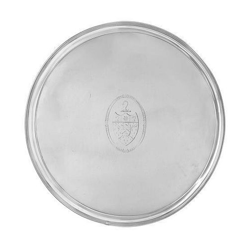 * A George III Silver Salver, Thomas Graham & Jacob Willis, London, 1790, of circular form with a reeded rim, the field cente