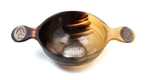 * A Scottish Horn Quaich, , of typical form, the bowl centered by a silver medallion engraved Slainte, the handles with inset