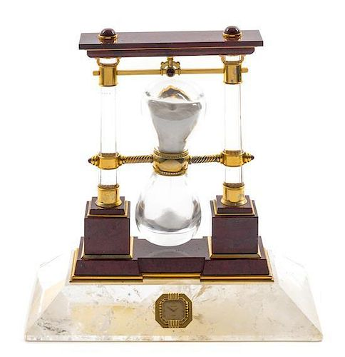A French Carved Jasper, Rock Crystal, Diamond and Silver-Gilt Desk Clock Height 12 1/4 x width 12 1/4 inches.