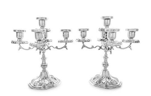 A Pair of Mexican Silver Five-Light Candelabra, Maciel, Mexico City, each having a central urn form candle cup with a lobed d