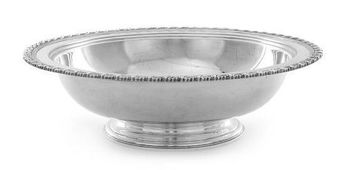 An American Silver Center Bowl, Tiffany & Co., New York, NY, the rim worked to show foliate banding, raised on a stepped circ