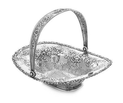 * An American Silver Center Bowl, Jacobi & Jenkins, Baltimore, MD, the swivel handle worked to show repousse floral and folia