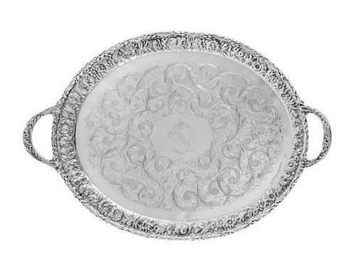 * An American Silver Serving Tray, S. Kirk & Son, Baltimore, MD, the twin-handled tray having a repousse floral and foliate b