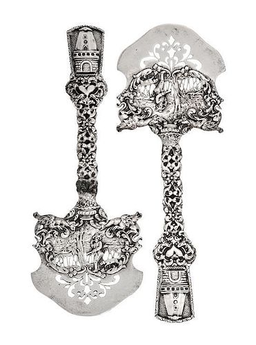 A Pair of American Silver Asparagus Servers, Marshall Field & Co., Chicago, IL, the openwork blade decorated with a hunter an