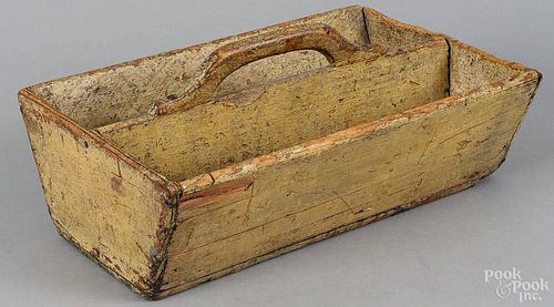 Painted pine utensil tray, 19th c., retaining an old mustard surface, 6'' h., 13 3/4'' w.