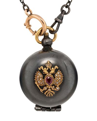 EARLY 20TH CENTURY RUSSIAN GOLD AND GUNMETAL COIN HOLDER LOCKET ON A CHAIN