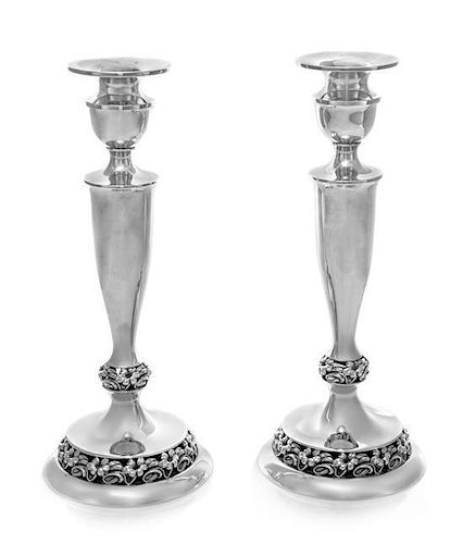 * A Pair of American Silver Candlesticks, Mueck-Carey, Mid-20th Century, of baluster form with openwork base.