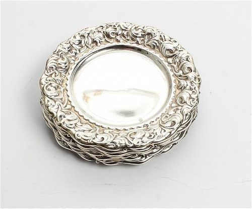 A Set of Eight American Silver Butter Dishes, Whiting Mfg. Co., New York, NY, each with repousee foliate decorated borders.
