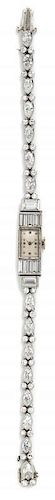 A Platinum and Diamond Wristwatch, 14.40 dwts.