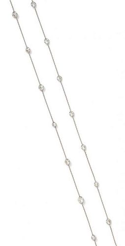 An 18 Karat White Gold and Diamond Station Necklace, 3.60 dwts.