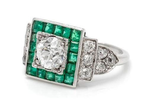 An Art Deco Platinum, Diamond and Emerald Ring, 5.70 dwts.