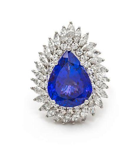 A Platinum, Tanzanite and Diamond Ring/Pendant, 10.80 dwts.