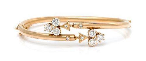 A 14 Karat Yellow Gold and Diamond Clover Motif Bypass Bangle Bracelet, 6.70 dwts.