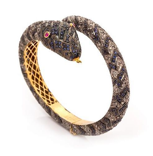 41a18fc9776 A Gilt Silver, Ruby, Sapphire and Diamond Snake Motif Bypass Bangle ...