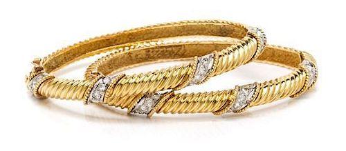 * A Pair of 18 Karat Yellow Gold and Diamond Bangle Bracelets, 26.00 dwts.