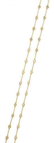 A 14 Karat Yellow Gold and Diamond Station Necklace, 5.70 dwts.