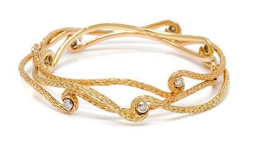 A Collection of 18 Karat Gold and Diamond Bangle Bracelets, Roberto Coin, 27.60 dwts.
