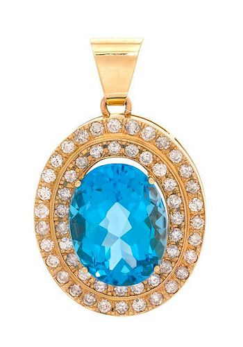 A Yellow Gold, Blue Topaz and Diamond Pendant, 12.90 dwts.