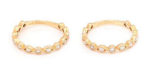 A Pair of 14 Karat Yellow Gold and Diamond Band Rings, MARS, 2.20 dwts.