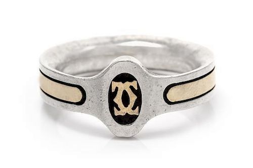 A Sterling Silver and 18 Karat Yellow Gold Ring, Cartier, 4.30 dwts.