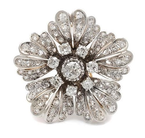 A Platinum Topped Gold and Diamond Floral Motif Brooch, 12.50 dwts.