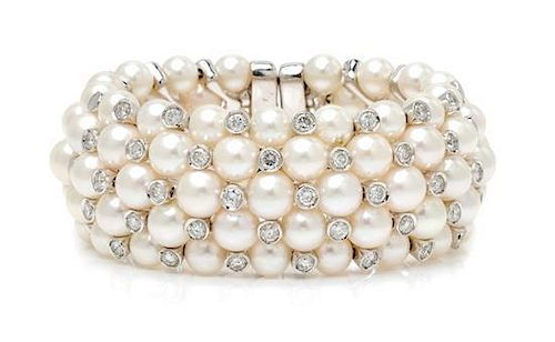 An 18 Karat White Gold, Diamond, and Cultured Pearl Cuff Bracelet, 68.90 dwts.