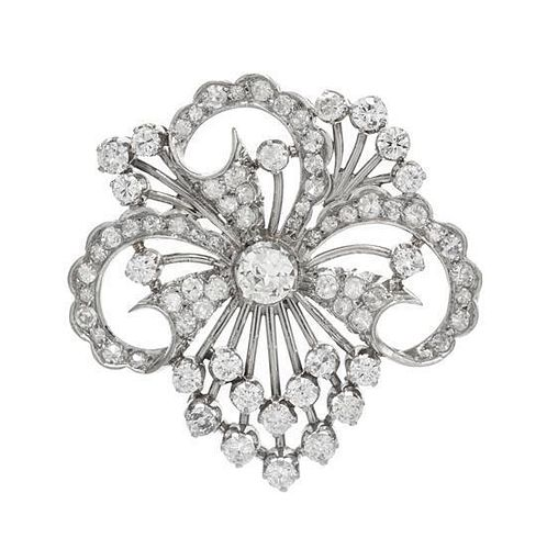 A Platinum and Diamond Floral Motif Brooch, 7.80 dwts.