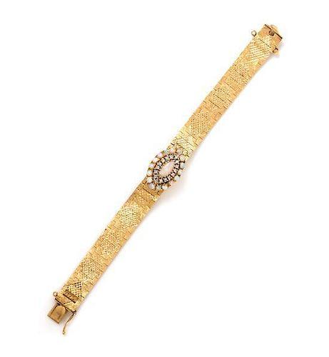 A 14 Karat Yellow Gold, Opal and Diamond Surprise Wristwatch, Luva, 26.40 dwts.
