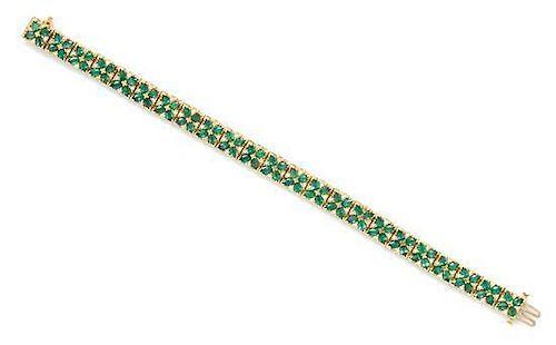 A 14 Karat Yellow Gold, Diamond and Emerald Bracelet, BITA, 13.30 dwts.