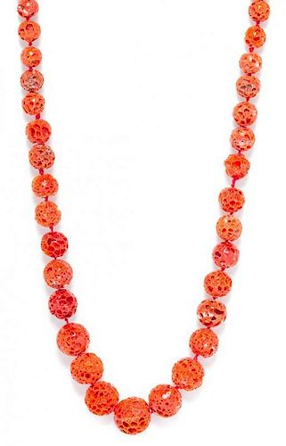A Graduated Single Strand Coral Bead Necklace,
