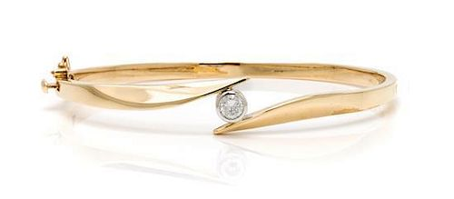 A 14 Karat Yellow Gold and Diamond Bangle Bracelet, 10.20 dwts.