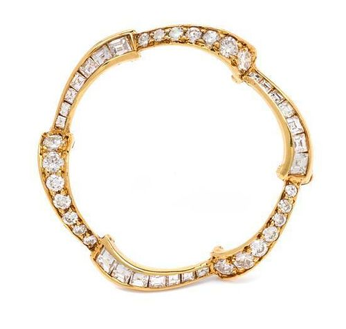 A Yellow Gold and Diamond Circle Brooch, 2.70 dwts.