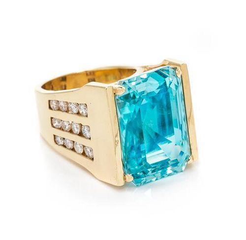 A 14 Karat Yellow Gold, Aquamarine and Diamond Ring,