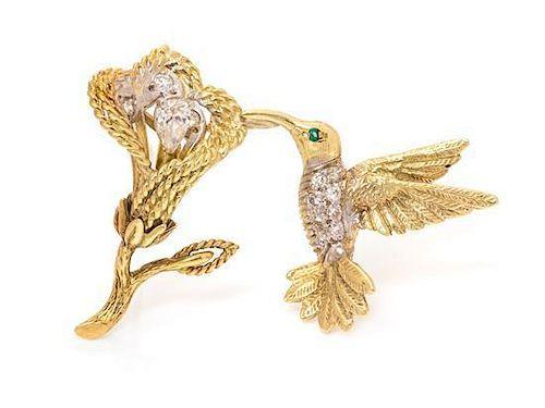 * An 18 Karat Yellow Gold, Diamond and Emerald En Tremblant Hummingbird Brooch, 6.40 dwts.