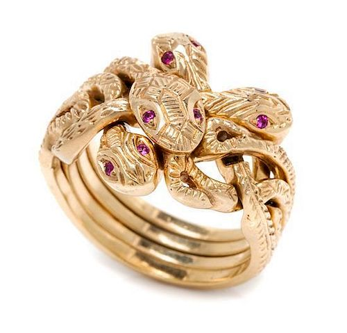 A Yellow Gold and Ruby Serpent Puzzle Ring, 12.20 dwts.