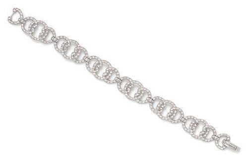 An 18 Karat White Gold and Diamond 'C' Bracelet, Charriol, 15.40 dwts.