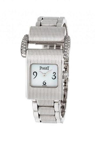 * An 18 Karat White Gold and Diamond Ref. 5222 'Miss Protocole' Wristwatch, Piaget, 50.00 dwts.