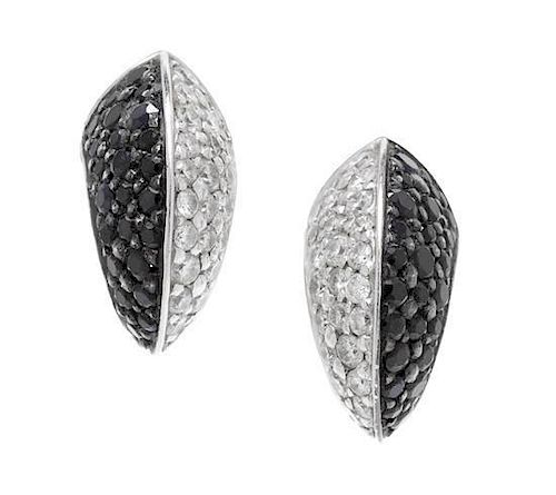 A Pair of 18 Karat White Gold, Diamond and Black Diamond Stud Earrings, Stephen Webster, 4.00 dwts.