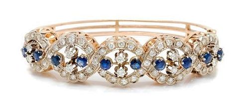 A 14 Karat Bicolor Gold, Sapphire and Diamond Bangle Bracelet, 22.90 dwts.