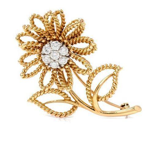 * An 18 Karat Yellow Gold and Diamond Flower Brooch, 11.10 dwts.