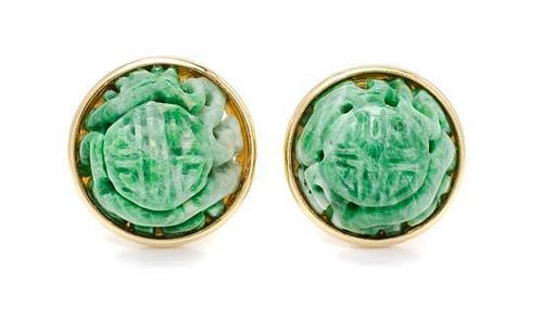 * A Pair of 18 Karat Yellow Gold and Carved Jade Earclips, 15.90 dwts.