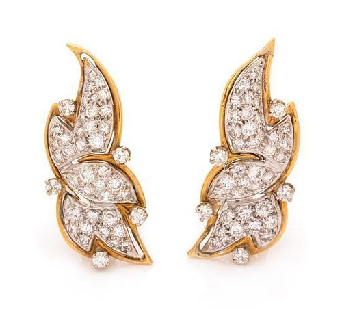 A Pair of Bicolor Gold and Diamond Earclips, 6.60 dwts.