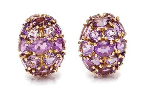 A Pair of 14 Karat Yellow Gold and Amethyst Earclips, 13.40 dwts.