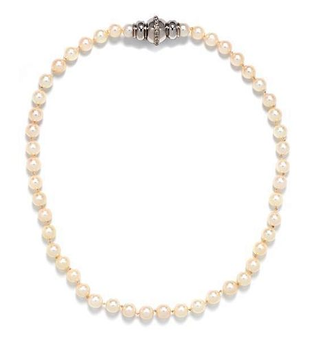 A 14 Karat White Gold, Diamond and Cultured Pearl Necklace, 33.50 dwts.